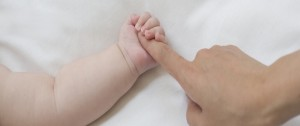 Mellow Parenting Vision & Values baby holding mother's finger