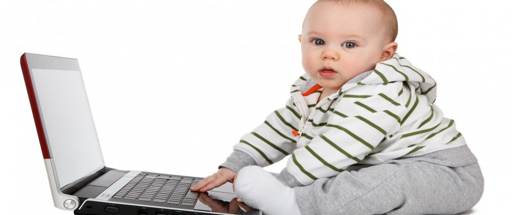 Contact Us - baby with laptop
