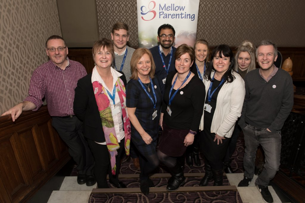 image of Mellow Parenting staff standing on stairs at the Grand Central Hotel Glasgow