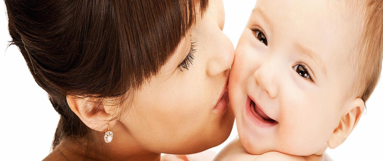Mellow Parenting mum kissing baby