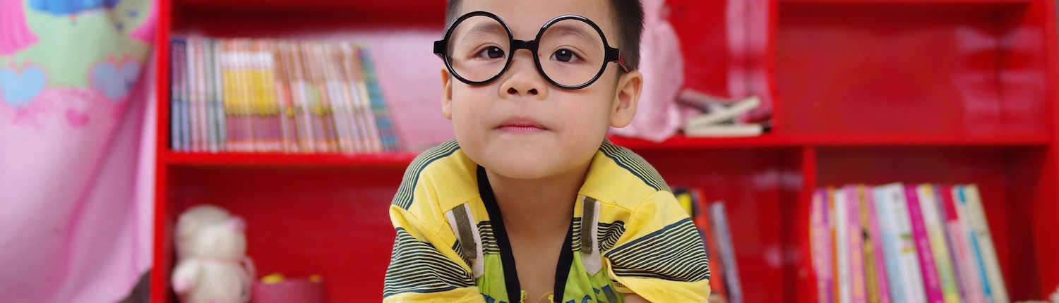 Mellow Parenting - Our Evidence - little boy with large glasses reading book