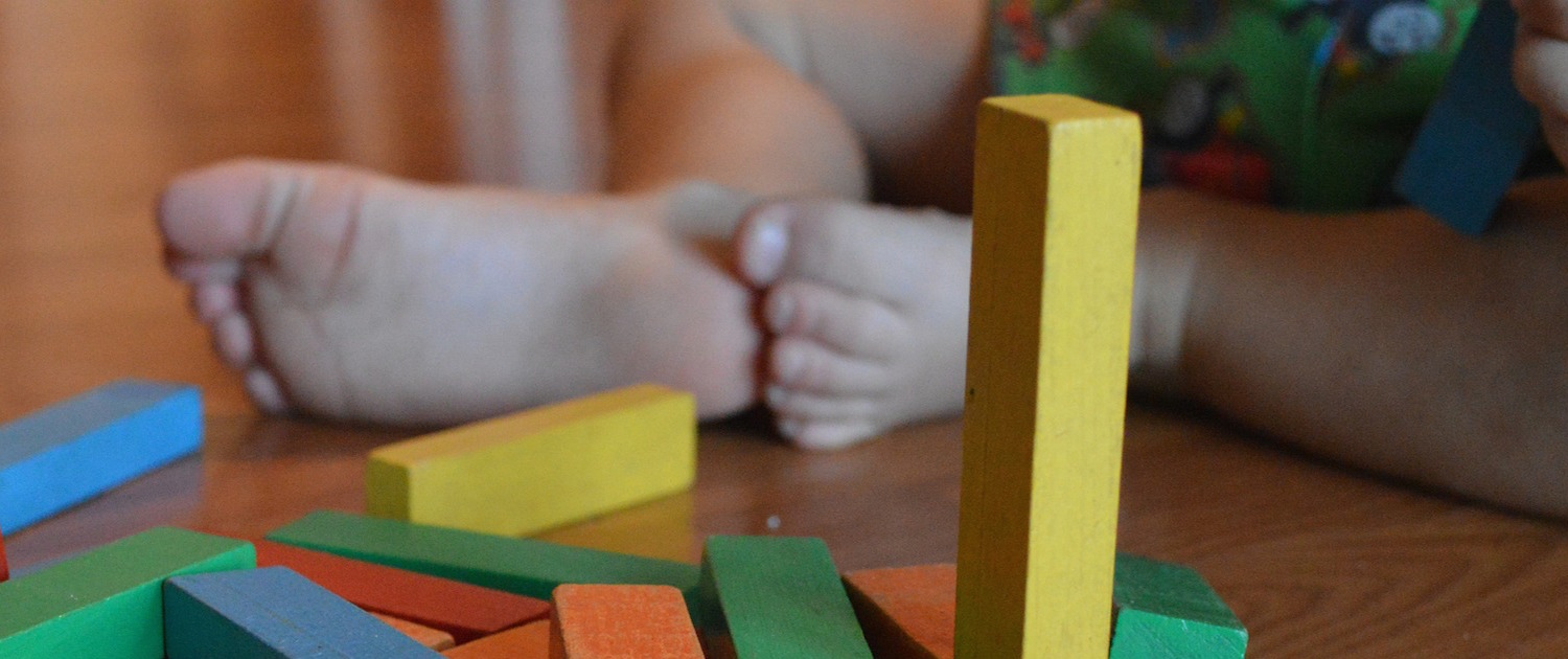 Mellow Parenting - Our Training - Other Training/Workshops baby with building blocks
