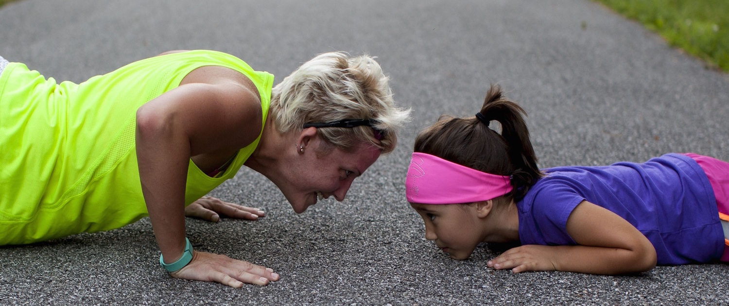 Mellow Parenting - our training - image of Mum and daughter doing push ups in sportswear